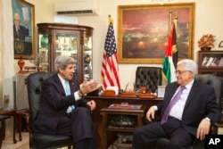 FILE - U.S. Secretary of State John Kerry, left, meets with Palestinian President Mahmoud Abbas in Amman, Jordan on Saturday, June 29, 2013, after shuttling to Jordan from Jerusalem in the morning.