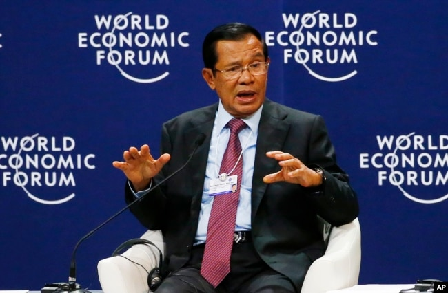 FILE - Prime Minister Hun Sen of Cambodia gestures as he talks about his vision for the Mekong region in the World Economic Forum on ASEAN at the National Convention Center in Hanoi, Vietnam, Sept. 12, 2018.