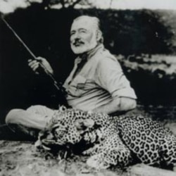 Ernest Hemingway poses with a dead leopard in 1953