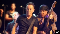 American performer Bruce Springsteen, left, performs during a soundcheck with band member Steven Van Zandt, right, before performing in Cape Town, South Africa, Jan. 26, 2014.