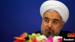 Iran's President Hassan Rouhani arrives to attend a news conference at a hotel after the fourth Conference on Interaction and Confidence Building Measures at the Asia summit, in Shanghai, May 22, 2014.