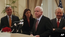 U.S. Senator John McCain (2nd R) speaks as Senators Joseph Lieberman, Sheldon Whitehouse (L) and Kelly Ayotte (2nd L) look on during a press briefing in Hanoi January 19, 2012, one of the stops on their visit to Asia.