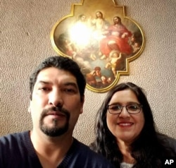 In this Dec. 2017, photo provided by Rachel Tovar, right, poses with her husband Arturo Tovar at a Catholic cathedral in Mexico City. Rachel Tovar, a former worker of the Fullmer Cattle Co., a western Kansas calf ranch, told the Associated press that the ranch forces immigrants to toil long days to work off loans from Fullmer Cattle Co. for the cost of smuggling them into the country. (Photo courtesy Rachel Tovar via AP)