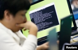 FILE - A student attends a white-hat hackers competition, co-hosted by the Defense Ministry and the National Intelligence Service, at the Korea Military Academy in Seoul, Sept. 29, 2013.