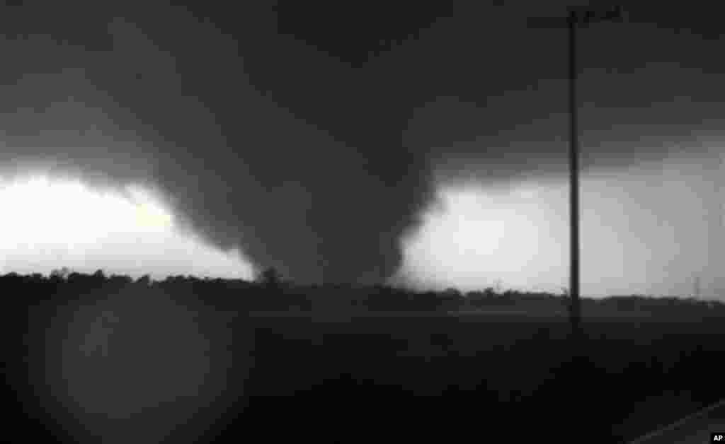 This frame grab from video shows a massive tornado on Sunday, May 22, 2011, outside Joplin, Mo. The tornado tore a 6-mile path across southwestern Missouri killing at least 89 people as it slammed into the city of Joplin, ripping into a hospital, crushin