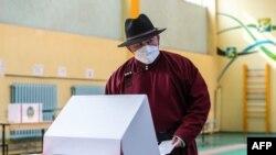 Mongolia's President Battulga Khaltmaa cast his ballot at a polling site in Ulaanbaatar