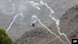 北約部隊巡邏阿富汗山區。