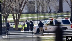 Law enforcement officers are seen gathered near the White House in Washington, March 3, 2018.