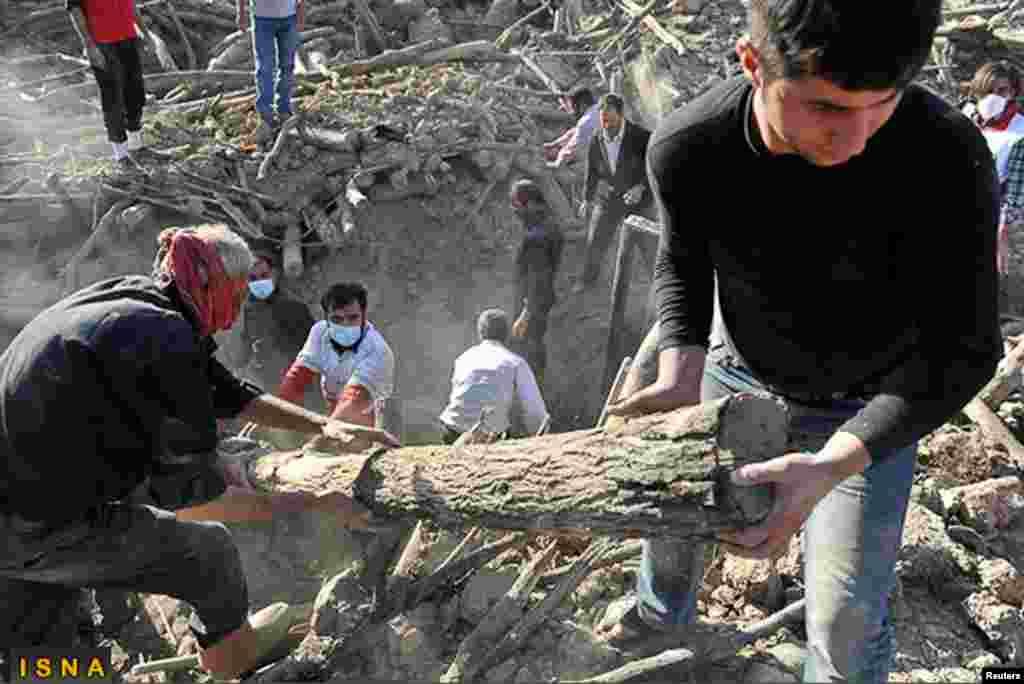 Rescue teams search for victims in Varzaqan near Ahar. Iran's government faced criticism from lawmakers and the public on its handling of relief efforts, August 12, 2012.