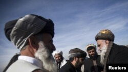 Members of the Afghan parliament congratulate each other after an inauguration ceremony in Kabul January 26, 2011.