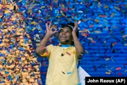 Zaila Avant-garde, 14, from Harvey, Louisiana is covered with confetti as she celebrates winning the finals of the 2021 Scripps National Spelling Bee July 8, 2021