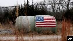 A U.S. flag is attached to a hay bale on a farm in Crete, Nebraska, Jan. 4, 2017.