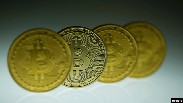 Mock Bitcoins are displayed on a table in an illustration picture taken in Berlin, Jan. 7, 2014.