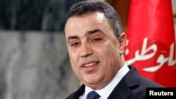 FILE - Tunisia's then prime minister Mehdi Jomaa speaks during a news conference in Tunis, Jan. 26, 2014.