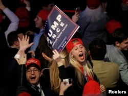 Trump supporters celebrate as they watch election returns come in at Republican presidential nominee Donald Trump