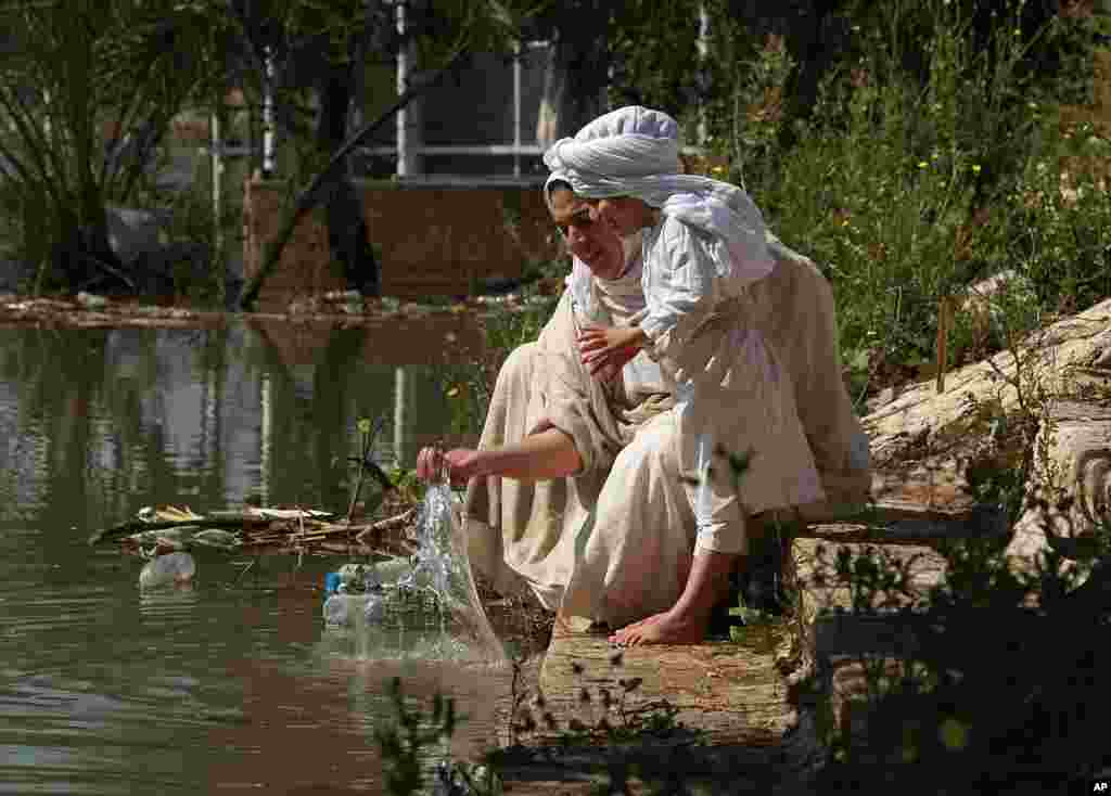 Followers of the Sabean Mandaeans, a pre-Christian sect that follows the teachings of John the Baptist, perform their rituals alongside the Tigris river during a celebration marking 'Banja' or Creation Feast in central Baghdad, Iraq.