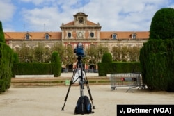 No news: TV camera crews parked outside the Catalan parliament have had long periods of downtime waiting for dramatic developments in the stop-start standoff between Barcelona and Madrid.
