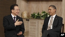 U.S. President Barack Obama meets with Chinese Premier Wen Jiabao on the sidelines of the East Asia Summit in Nusa Dua, in Bali, Indonesia, Saturday, Nov. 19, 2011.