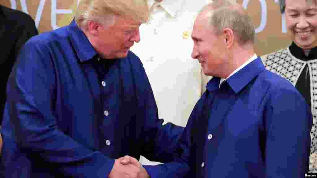 President Trump greets Russian President Vladimir Putin.