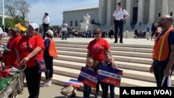 Protesters are seen in front of the U.S. Supreme Court in Washington as justices hear arguments on a citizenship question the Trump administration wants to add to the census questionnaire, April 23, 2019.