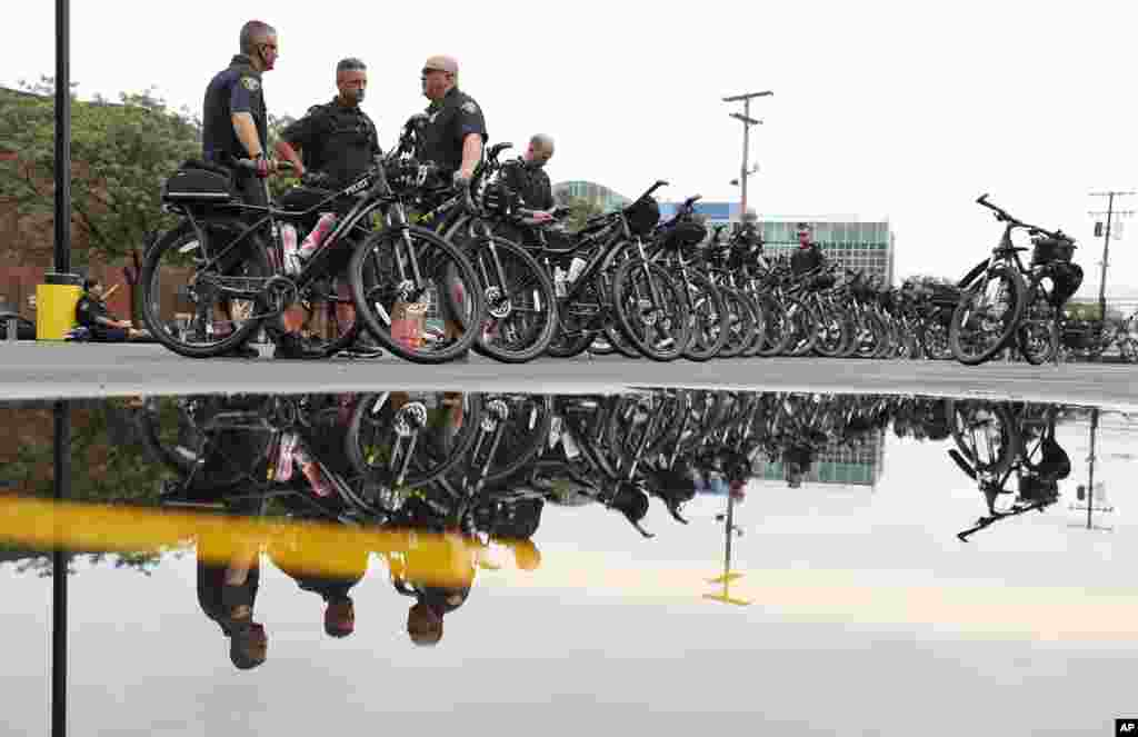 Cleveland bicycle police officers wait for their next assignments as preparations continues for the Republican National Convention in Cleveland, July 16, 2016.
