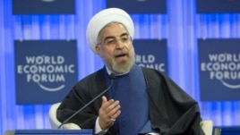 Iranian President Hassan Rouhani, gestures as speaks during a session of the World Economic Forum in Davos, Switzerland, Jan. 23, 2014.