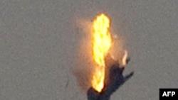 Một chiến đấu cơ của phe ông Gadhafi bị lực lượng nổi dậy bắn rơi ở Benghazi hôm 19/3/11