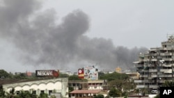 Smoke rises from the city centre of Abidjan April 1, 2011 as fierce fighting spread across the city.