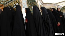 FILE - Women stand in line to vote during the Iranian presidential election at a mosque in Qom, 120 km (74.6 miles) south of Tehran, June 14, 2013.