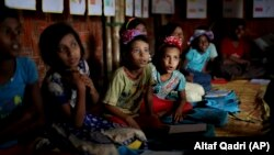 FILE - In this Aug. 27, 2018, photo, Rohingya refugee children attend a UNICEF run school in Balukhali refugee camp, Bangladesh. (AP Photo/Altaf Qadri)