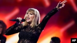 FILE - Taylor Swift performs at DIRECTV NOW Super Saturday Night Concert at Club Nomadic, Feb. 4, 2017, in Houston, Texas.