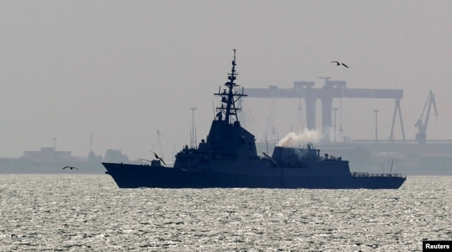 FILE - Spanish navy frigate Mendez Nunez arrives at Spain's Rota naval port, March 22, 2011.