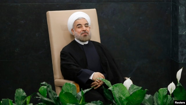 Iran's President Hassan Rouhani waits to address the United Nations General Assembly at U.N. headquarters. Sept. 24, 2013