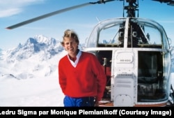 Francois-Xavier Bagnoud standing by a search-and-rescue helicopter.