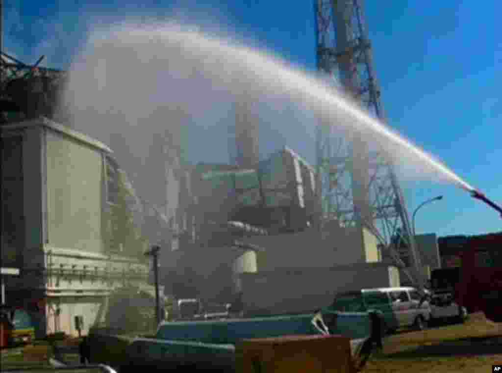 A fire truck sprays water at No. 3 reactor of the Fukushima Daiichi nuclear power plant after the 2011 earthquake and tsunami damaged the facility. (Reuters/Self Defense Force Nuclear Biological Chemical Weapon Defense Unit via Reuters TV)