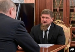 FILE - Russian President Vladimir Putin, left, meets with Chechnya's regional leader Ramzan Kadyrov in the Kremlin in Moscow, Russia, April 19, 2017.