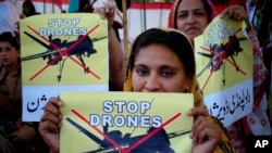 FILE - Women supporters of a political party rally against the U.S. drone strikes in Pakistani tribal areas, in Peshawar, Pakistan.