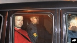 Norway's twin terror attacks suspect Anders Behring Breivik, left, sits in an armored police vehicle after leaving the courthouse following a hearing in Oslo, July 25, 2011 where he pleaded not guilty to one of the deadliest modern mass killings in peacet