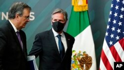Secretary of State Antony Blinken, right, departs with Mexico's Foreign Minister Marcelo Ebrard after a joint news conference at the Mexican Ministry of Foreign Affairs, in Mexico City, Oct. 8, 2021.