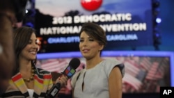 Actress Eva Longoria, right, is interviewed by Mariana Atencio of Univision on the floor of the Democratic National Convention in Charlotte, N.C., Sept. 6, 2012.
