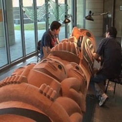 David Boxley works at the National Museum of the American Indian in Washington on one of the totem poles that he created with his son