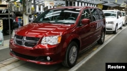 FILE - Fiat Chrysler's Dodge minivans move down the final production line at the Windsor Assembly Plant in Windsor, Ontario, February 9, 2015.