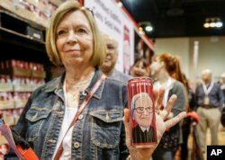 Berkshire Hathaway shareholder Barb Whitelock of Omaha stands in line to buy a commemorative Coca Cola can made for the Chinese market that features the likeness of Warren Buffett, at the CenturyLink Center in Omaha, Neb., May 5, 2017.