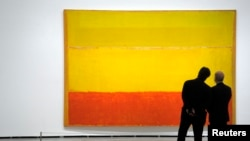 "Visitors eye ""Untitled,"" a 1952-3 abstract expressionist painting by U.S. artist Mark Rothko at Bilbo's Guggenheim Museum in 2011."