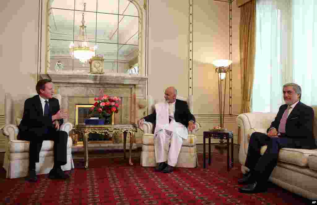 Afghanistan's president Ashraf Ghani Ahmadzai and Afghanistan's chief executive Abdullah Abdullah listen to Britain's Prime Minister David Cameron during their meeting at the presidential palace in Kabul, Afghanistan, Oct. 3, 2014.