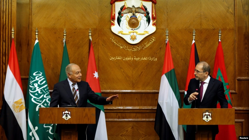 Jordanian Foreign Minister Ayman Safadi (R), and Arab League Secretary-General Ahmed Aboul Gheit speak during their joint news conference in Amman, Jordan, Jan. 6, 2018.