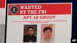 Bích chương hai nghi can tin tặc Trung Quốc đựơc trưng bày tại Bộ Tư pháp Mỹ ngày 20/12/2018.
