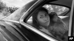 "In this image released by Netflix, Yalitza Aparicio in a scene from ""Roma"" by Alfonso Cuarón. On Tuesday, Aparicio was nominated for an Oscar for Best Actress for her work in the film. (Netflix via AP)"