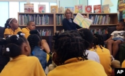 Education Secretary Betsy DeVos reads to students at Eagle Academy Public Charter School in Washington, Friday, June 2, 2017.