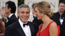 George Clooney and Stacy Keibler arrive at the 69th Annual Golden Globe Awards in Los Angeles